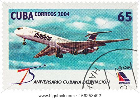 MOSCOW RUSSIA - January 16 2017: A stamp printed in Cuba shows passenger aircraft IL 62M series