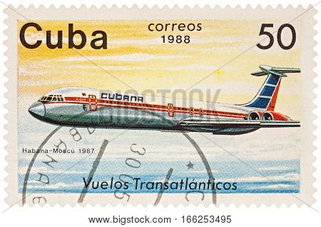 MOSCOW RUSSIA - January 17 2017: A stamp printed in Cuba shows passenger airliner Ilyushin IL-62 Flight Havana-Moscow (1987) series