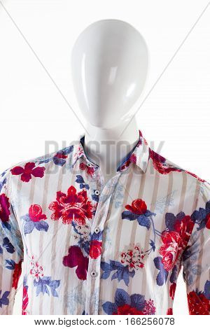 Striped floral shirt on mannequin. Male mannequin in trendy shirt. Men's trendy pattern shirt. Fashionable garment for men.