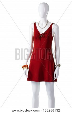 Red keyhole dress on mannequin. Female mannequin wearing keyhole dress. Bright dress with keyhole neckline. Lady's garment of soft fabric.