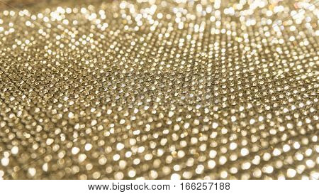 Blurred diamond crystal glitter lights background golden holidays twinkle lights