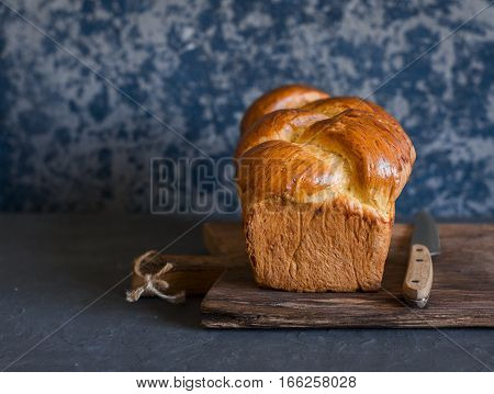 Homemade brioche on a dark background. Front view. Delicious pastries
