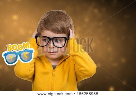 Cute schoolboy thinking idea while wearing glasses and looking at up