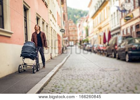 Young father taking his baby out to the city, enjoying a happy time in Heidelberg, Germany.