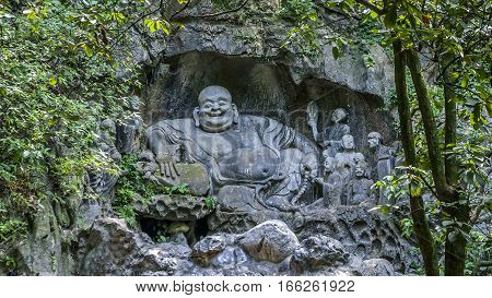 China Hangzhou. Monastery Soul SanctuaryTemple (Lininsy). Sculpture laughing Buddha - Hotei. It is believed that touching the stomach sculpture brings luck and happiness.