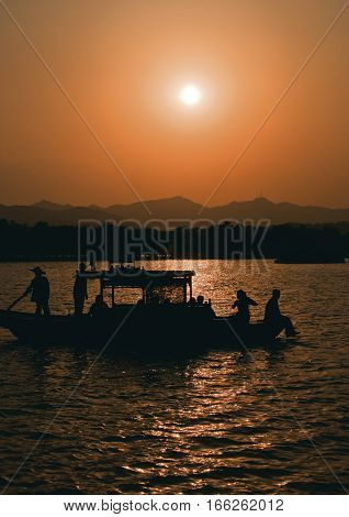 China Hangzhou. Paradise in heaven and on earth - Hangzhou and Suzhou - Chinese proverb . Sunset at West Lake (Xihu)- Hangzhou main attractions .