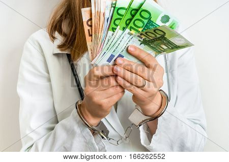 Doctor With Euro Money And Handcuffs - Bribe Concept