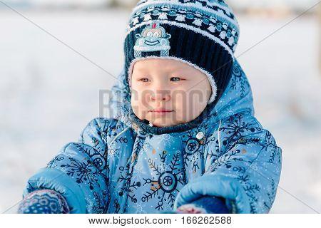 Portrait of little boy in winter closeup