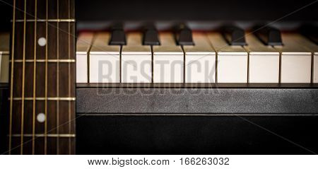 Musical Instruments Piano Keys And Acoustic Guitar