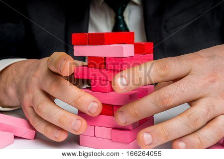 Businessman Builds Big Tower With Jenga Bricks