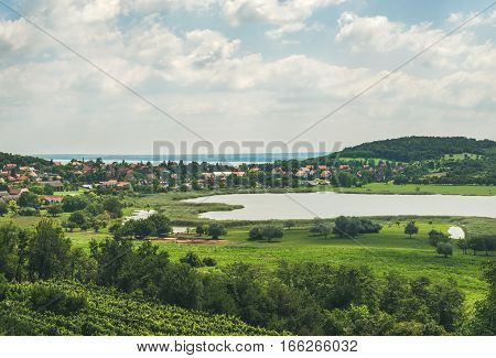 View over lake, wineyards and Tihany village at Lake Balaton coast, Hungary