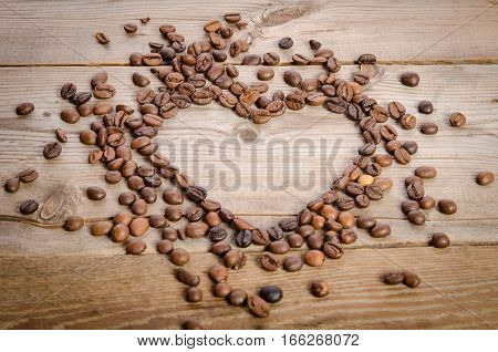 Frame- Heart From Coffee Beans On  Wooden Table