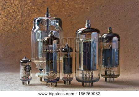 electronic background with different tipes vacuum tubes on kraft paper