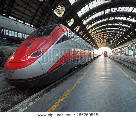 MILAN ITALY - CIRCA JANUARY 2017: Freccia Rossa Italian high speed train departing from Milano Centrale central railway station