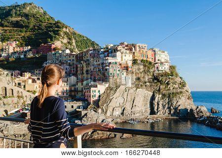 Young Girl Enjoying The View Of Manarola In Cinque Terre, Liguria, Italy.