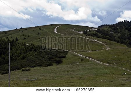 Velka Fatra mountrains near Kralova studna water spring with mountain meadow, hiking trails and Krizna hill on the background in Slovakia