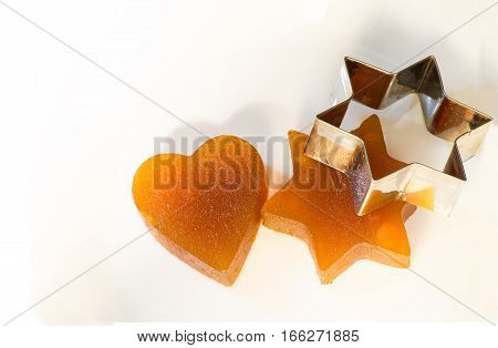 Candied fruit jelly apricot in the form of heart and star of David with iron form