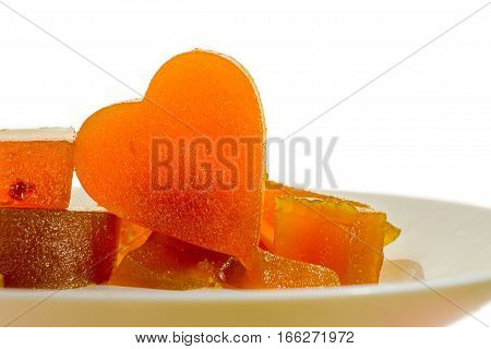 Apricot jelly on a white plate with isolated white background