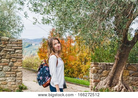 Young Girl Strolling Through San Gimignano On Autumn Warm Day. Tuscany, Italy