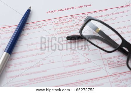 Health Insurance Claim Form With Pen And Glasses