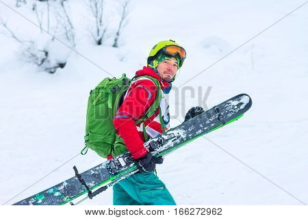 Freerider Skier With Skis In Hand Is Smiling, Portrait, Isolate