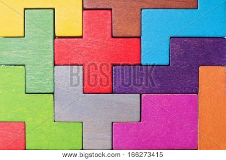 Abstract Background. Background with different colorful shapes wooden blocks . Geometric shapes in different colors. Concept of creative logical thinking or problem solving.
