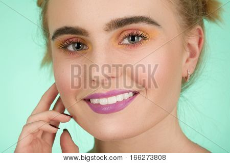 happy beautiful woman model with professional makeup over green background