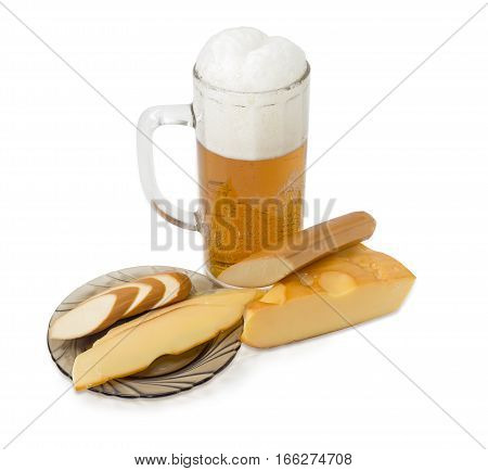 Beer glass with lager beer piece of a smoked hard cheese stick of smoked processed cheese and slices of the same smoked cheeses on a saucer on a light background