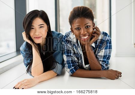 Asian Girl Next To Her Afro American Friend