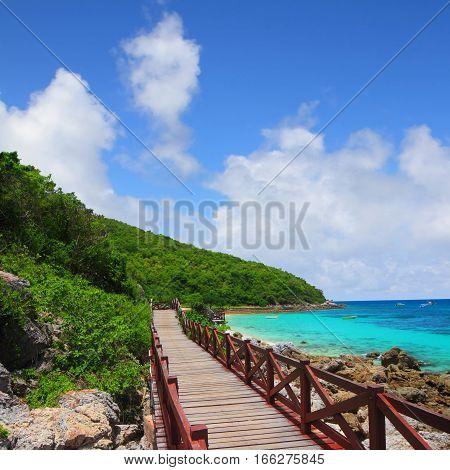 jetty to a tropical beach on island with blue sky at koh lan island Pattaya city Chonburi Thailand