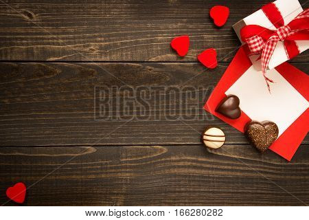 Valentine's Day Background. Gift Box, Red Hearts And Valentine's Day Card With Copy Space On The Woo