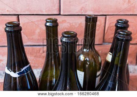 Empty wine bottles symbolizing alcoholism and alcohol addiction