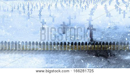 Brass ammunition with a lead bullets row in a cemetery with concrete crosses during the winter snowfall