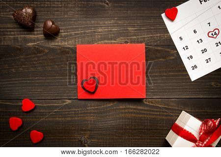 Valentine's Day Background With Copy Space. Valentine's Day Card, Gift Box And Chocolate On The Wood
