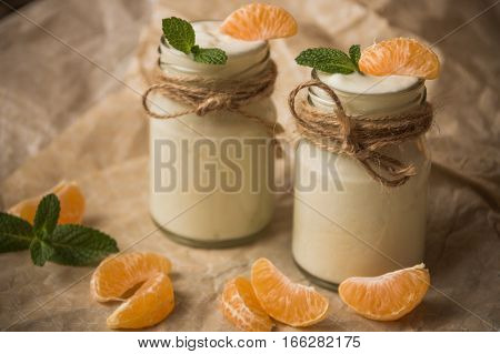 Organic Yougurt With Fresh Tangerine And Mint In Glass Jars