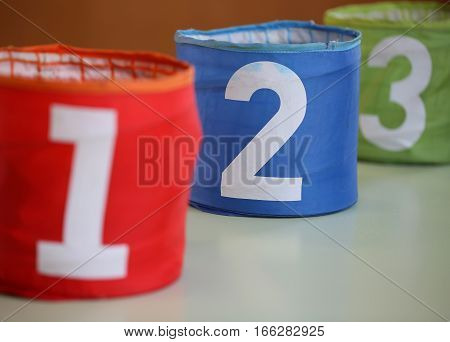Three Jars For Toys With Numbers One Two Three And The Number Tw