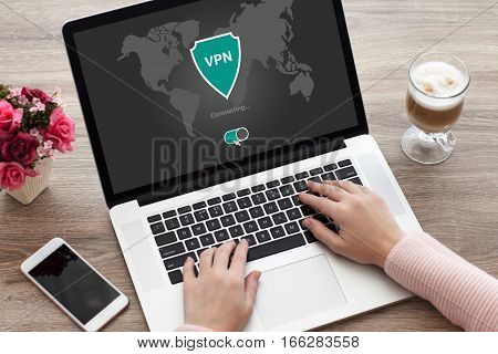 woman holding notebook with app vpn creation Internet protocols for protection private network