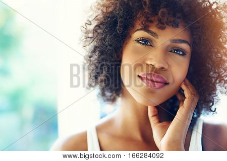 Portrait Of Smiling Young Black Woman In Sunshine