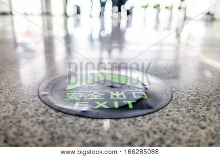 Exit Sign On Stone Floor In Perspective View
