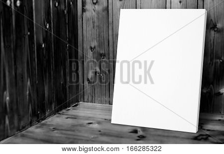 Blank White Poster Leaning At Black And White Wooden Wall In Plank Wood Room,mock Up For Adding Your