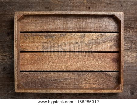 empty wooden box on old wooden background (top view dark)