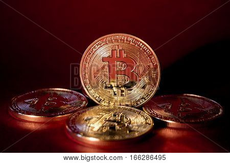 Golden Bitcoins On Red Background. Trading Concept Of Crypto Currency