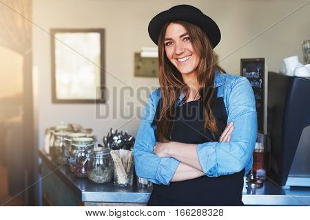 Young Female Smiling Staff Posing In Cafe
