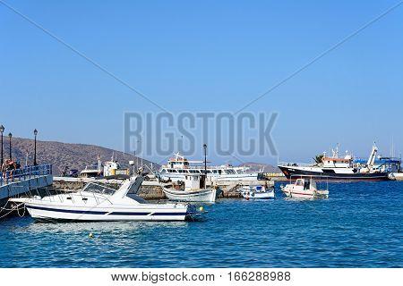 AGIOS NIKOLAOS, CRETE - SEPTEMBER 17, 2016 - Boats moored in the harbour Agios Nikolaos Crete Greece Europe, September 17, 2016.