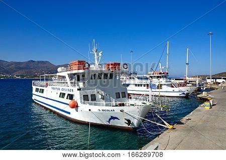 AGIOS NIKOLAOS, CRETE - SEPTEMBER 17, 2016 - Cruise boats moored in the harbour Agios Nikolaos Crete Greece Europe, September 17, 2016.