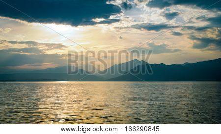 Sunset landscape scene over Lake Garda Italy.