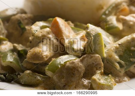 White rice and chicken cooked with vegetarian