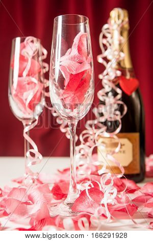 An extravagant valentine's day treat for two with a pair of champagne flute glasses and a bottle of fizz.