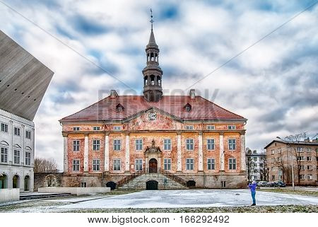 NARVA, ESTONIA - JANUARY 2, 2017: Old Town Hall Building and Square. On the left side is fragment of Narva College of University of Tartu. Winter view