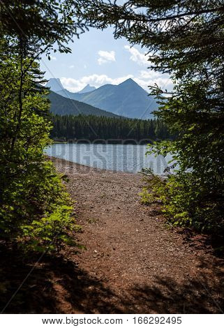 A summer countryside view of the lakes and mountains in the Canadian national park at Banff on a calm and bright summers day.